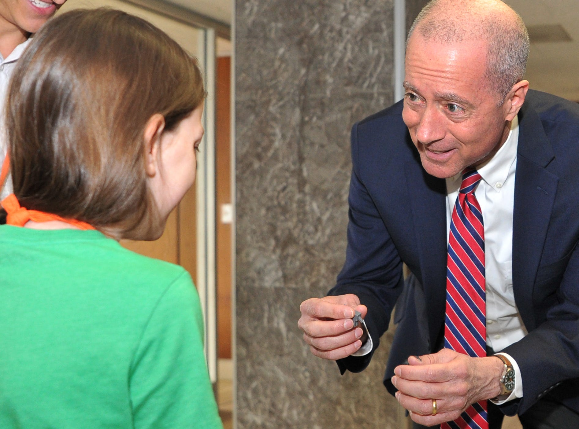 13th District, U.S Congressman, Mac Thornberry, right, talks with Dexter Learning student Reilley Havins, 11, about a 3D project she made while studying at the learning center located inside of the Big Blue building.