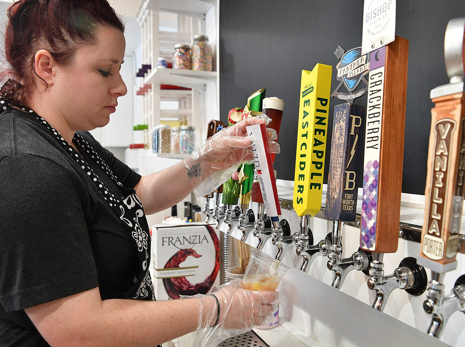 Brenna Pohlod, owner of Clink!, an adult dessert bar, begins making one of her signature alcohol-infused desserts. The new business offers fresh fruits, ice creams, sorbets, cupcakes and snow cones made with alcohol.
