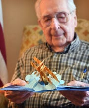 Joe Cuba enjoys a pop-up birthday card in advance of his 100th birthday which will be March 2. Cuba, a veteran of World War II, is asking to receive 100 birthday cards for his 100th birthday.