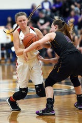 Sheridan's Emma Conrad, left, and Unioto's Emiley Coleman fight for the ball during the fourth quarter of the Generals' 35-31 win in a Division II district semifinal at Southeastern High School.