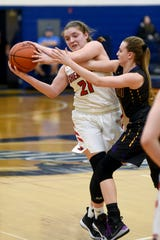 Sheridan's Kendyl Mick is crowded by a Unioto defender during Sheridan's 35-31 win in a Division II district semifinal on Wednesday at Southeastern High School.