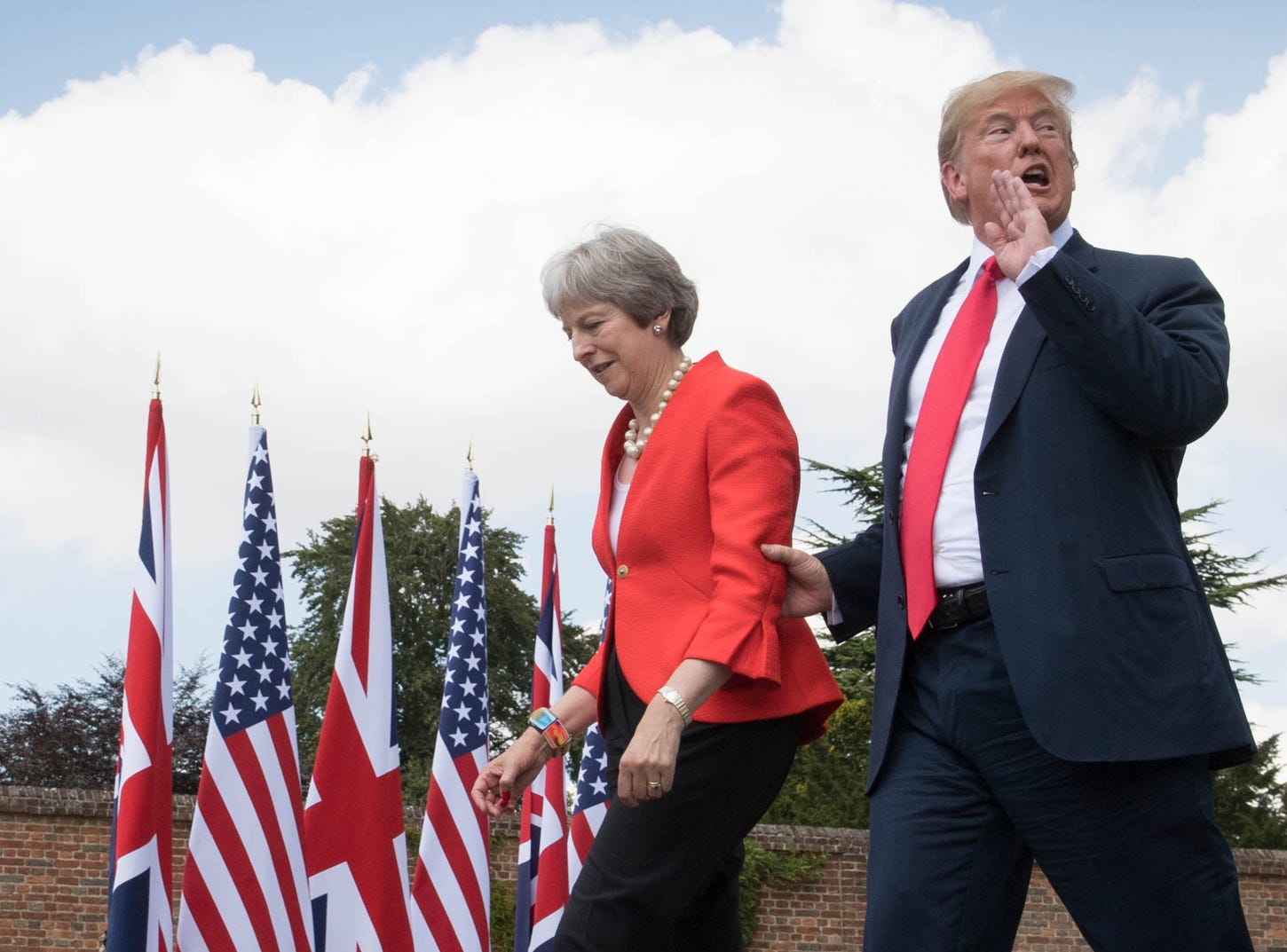 President Trump and Britain's Prime Minister Theresa May approach the lecturns for a joint press conference following their meeting at Chequers, the prime minister's country residence, near Ellesborough, northwest of London on July 13, 2018.
