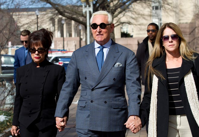 Roger Stone, a ormer campaign adviser for President Donald Trump, accompanied by his wife Nydia Stone, left, and daughter Adria Stone, arrives at federal court in Washington on Feb. 21, 2019. Stone was ordered to appear in court over a Instagram post he made about U.S. Judge Amy Berman Jackson.