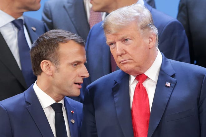 French President Emmanuel Macron and President Donald Trump talk during the opening day of Argentina G20 Leaders' Summit 2018 in Buenos Aires.