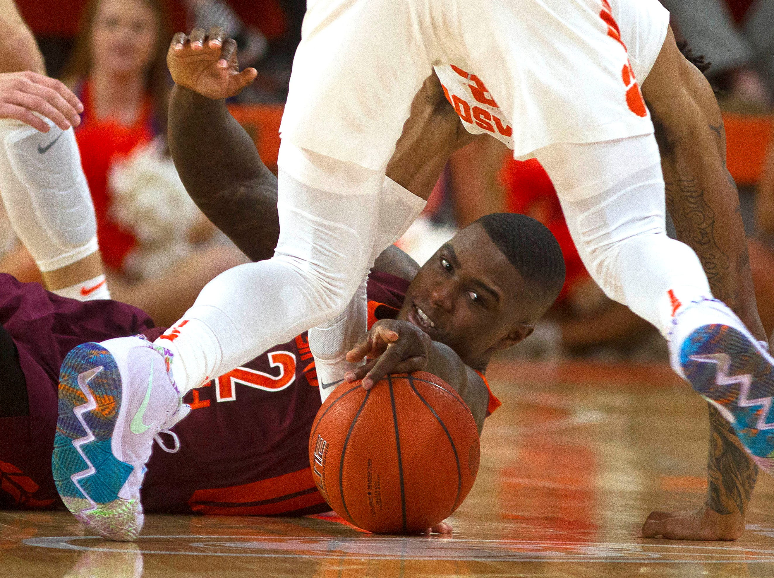 Feb. 9: Virginia Tech Hokies guard Ty Outlaw (42) tries to grab a loose ball against Clemson Tigers guard Marquise Reed (2) during the second half at Littlejohn Coliseum.
