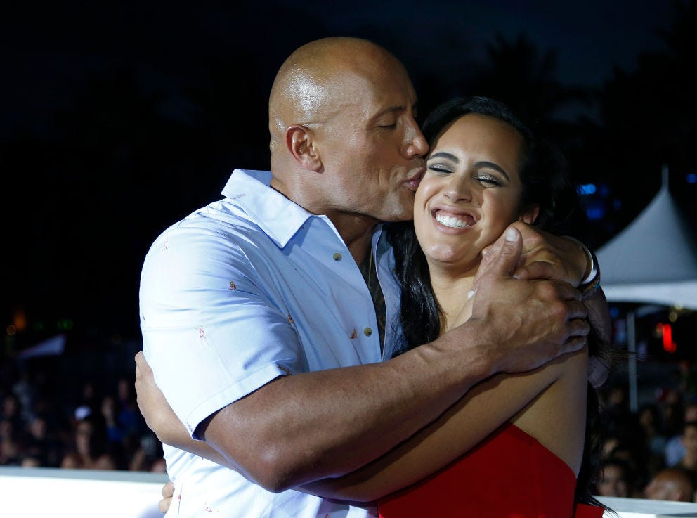 Actor Dwayne 'The Rock' Johnson kisses his daughter Simone as they attend Paramount Pictures' World Premiere of 'Baywatch' on Miami Beach, Florida on May 13, 2017.