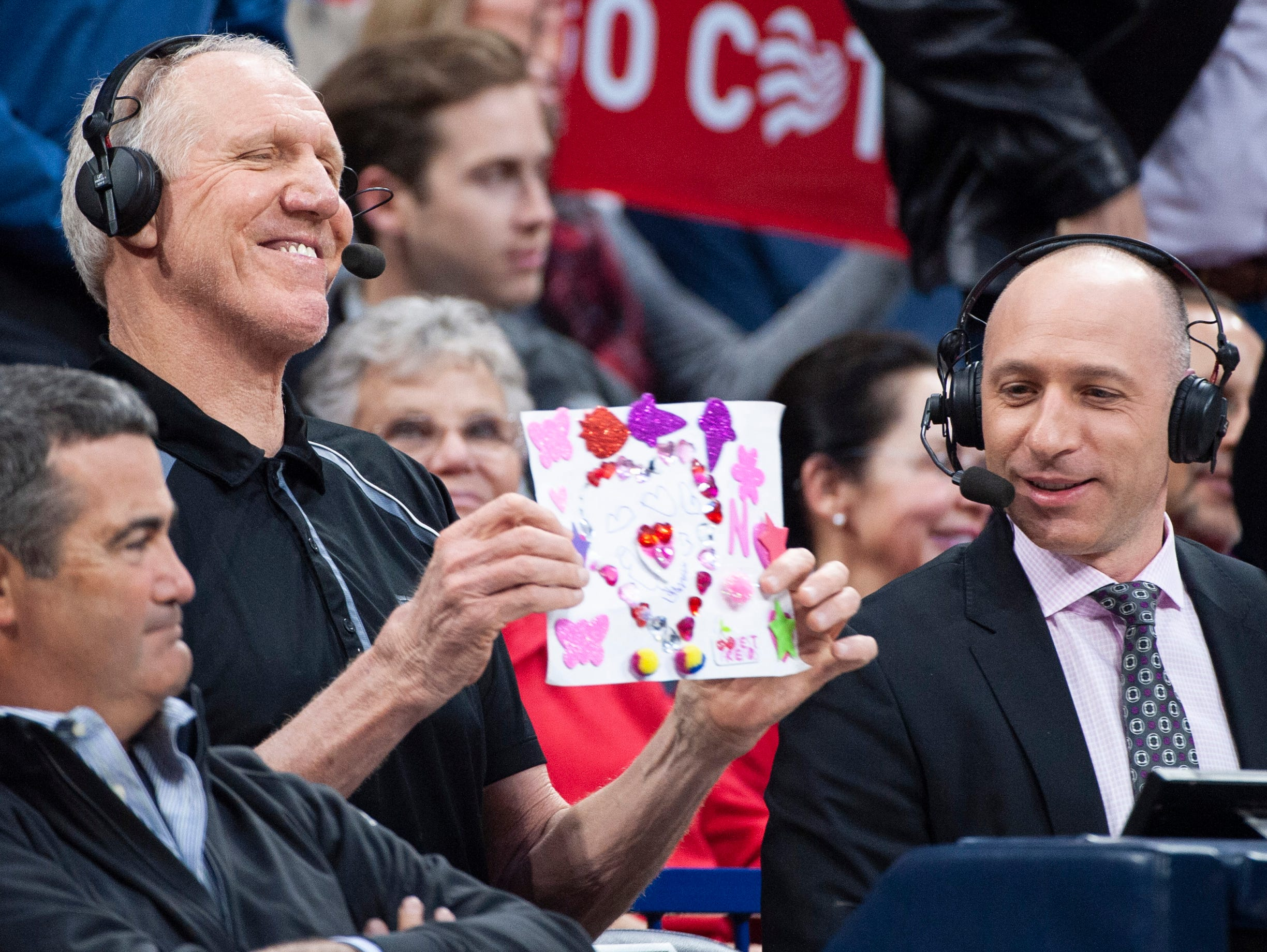 Feb. 7: ESPN's Bill Walton (left) and Dave Pasch (right) hold up drawings for the camera as the Arizona Wildcats play the Washington Huskies during the first half at McKale Center.