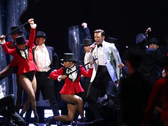 "Hugh Jackman performs the title song from ""The Greatest Showman"" at the Brit Awards in London, Wednesday."