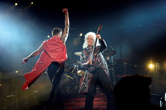 Lead guitarist Brian May, right, of Queen and singer Adam Lambert at a performance in Madrid in 2018. Lambert will appear with the band to open Sunday's Academy Awards show.