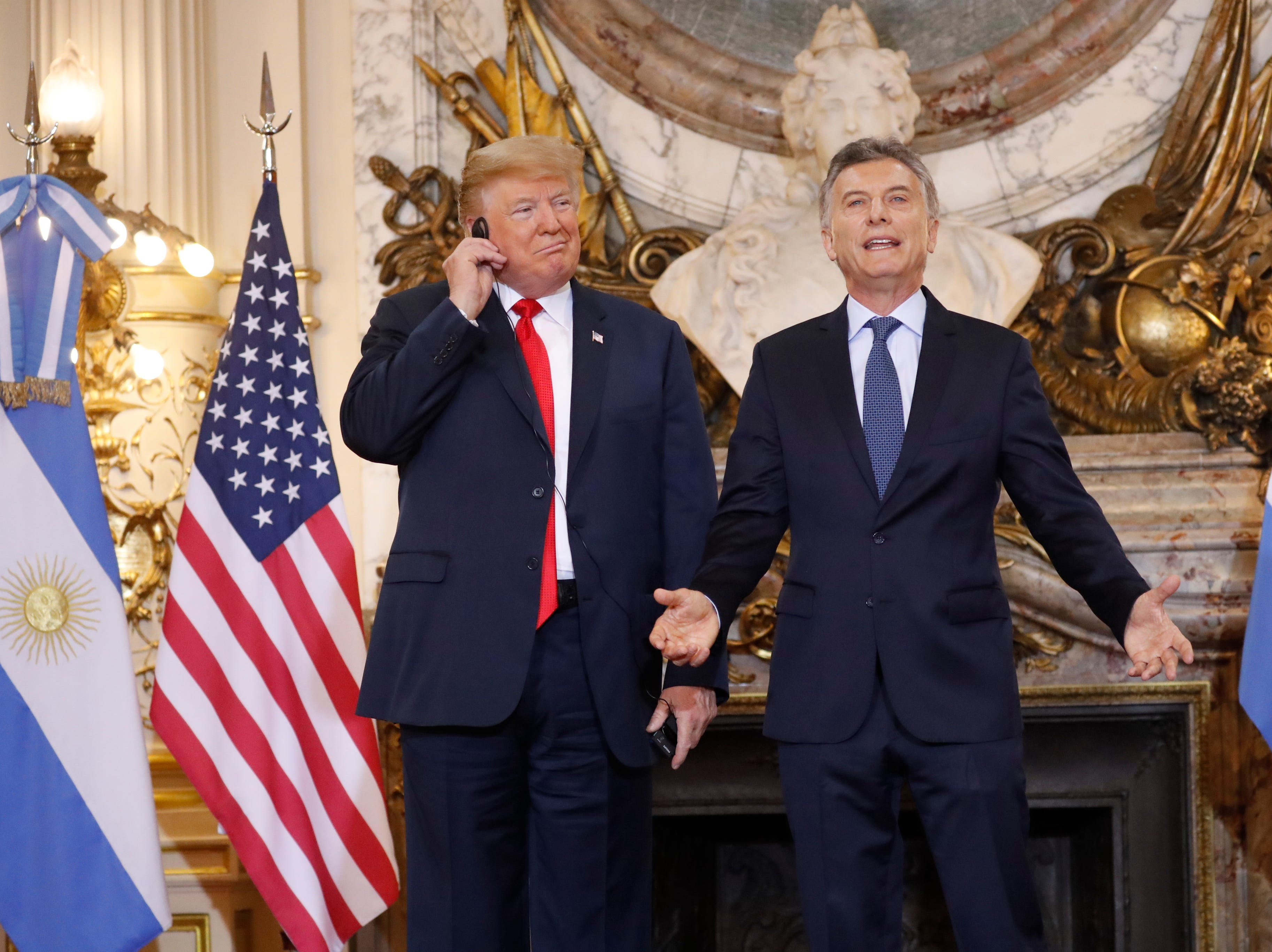 President Trump listens to the translation as Argentina's President Mauricio Macri speaks during their meeting at Casa Rosada on Nov. 30, 2018, in Buenos Aires, Argentina.