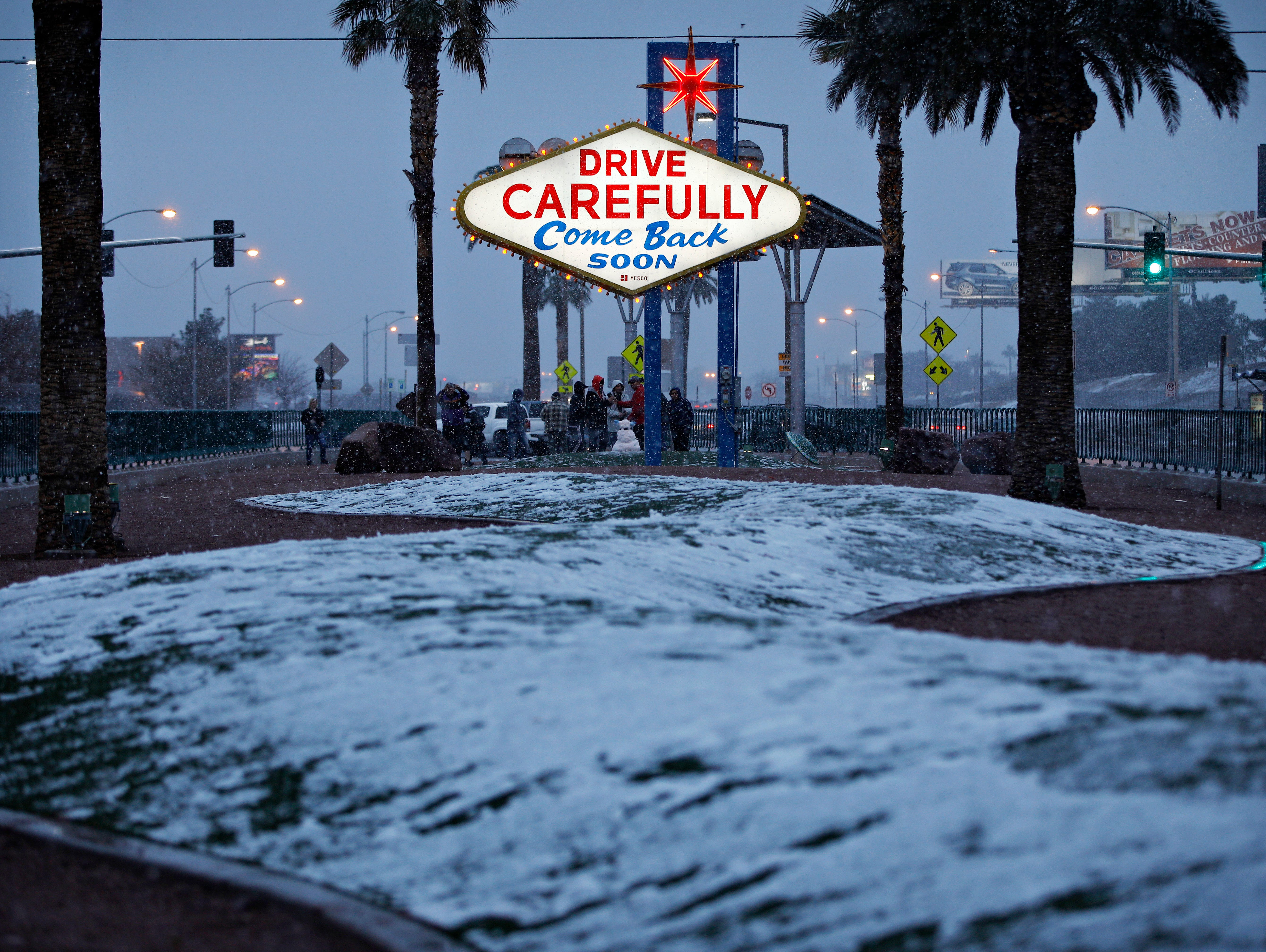 """Snow accumulates on a median at the """"Welcome to Fabulous Las Vegas"""" sign on Feb. 21, 2019."""