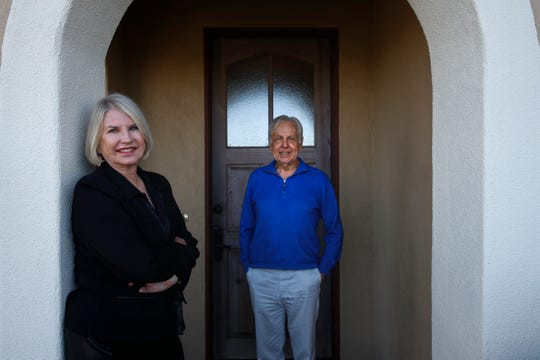Debbie Douglas, left, and her husband and business partner, Gary, pose for a photo in Newport Beach, Calif. on Feb. 6, 2019.