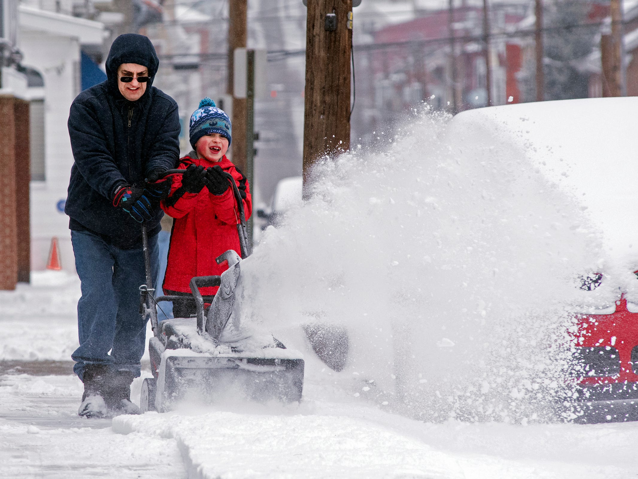 David Slodysko Sr. teaches his grandson, David Slodysko III, how to use a snow blower in Shamokin, Pa., on Feb. 20, 2019. About 4 inches of snow fell in central Pennsylvania.