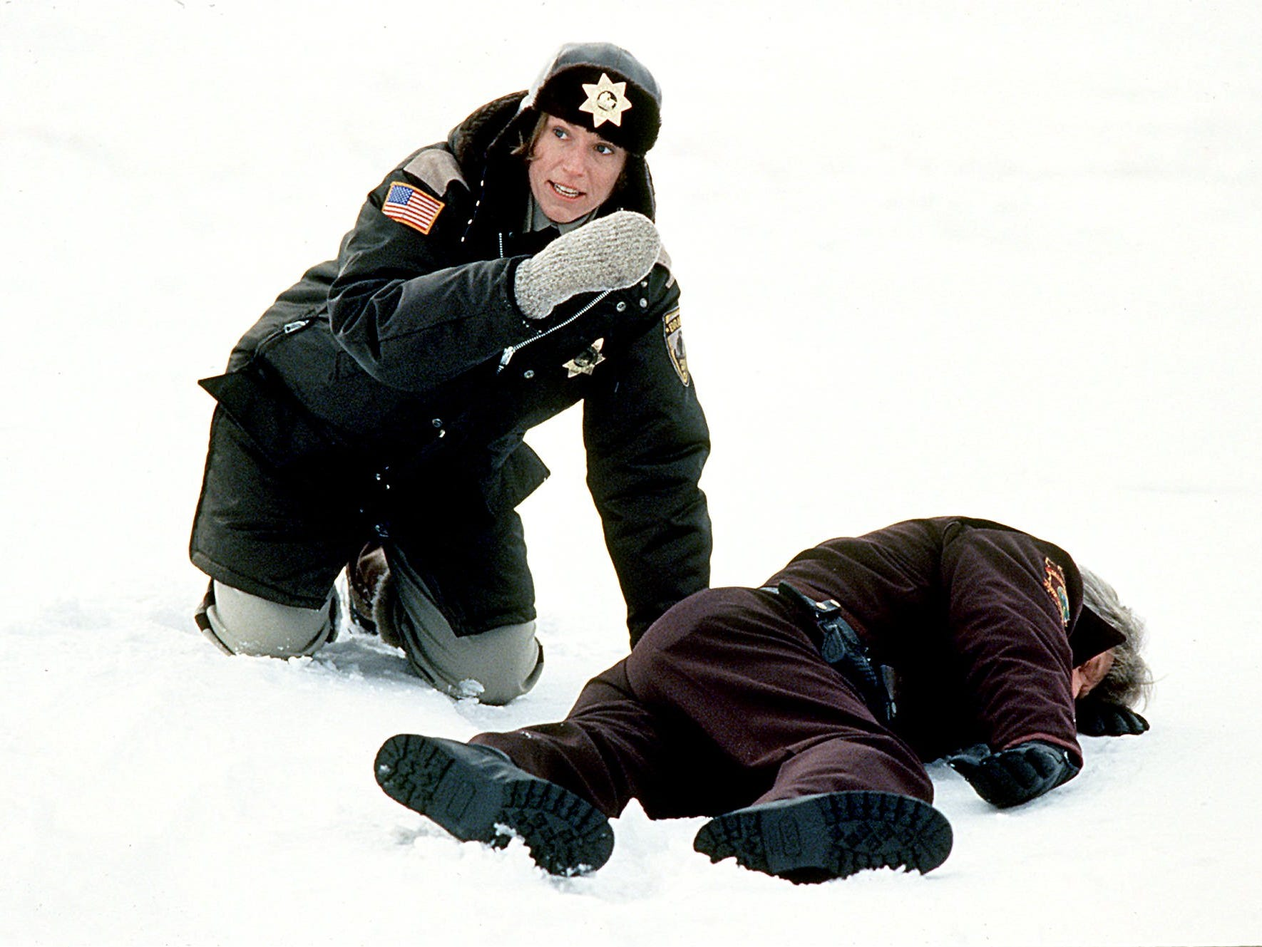 """Police Chief Marge Gunderson played by Frances McDormand looks for evidence at the crime scene in the new film """"Fargo""""  a film by Joel and Ethan Coen."""