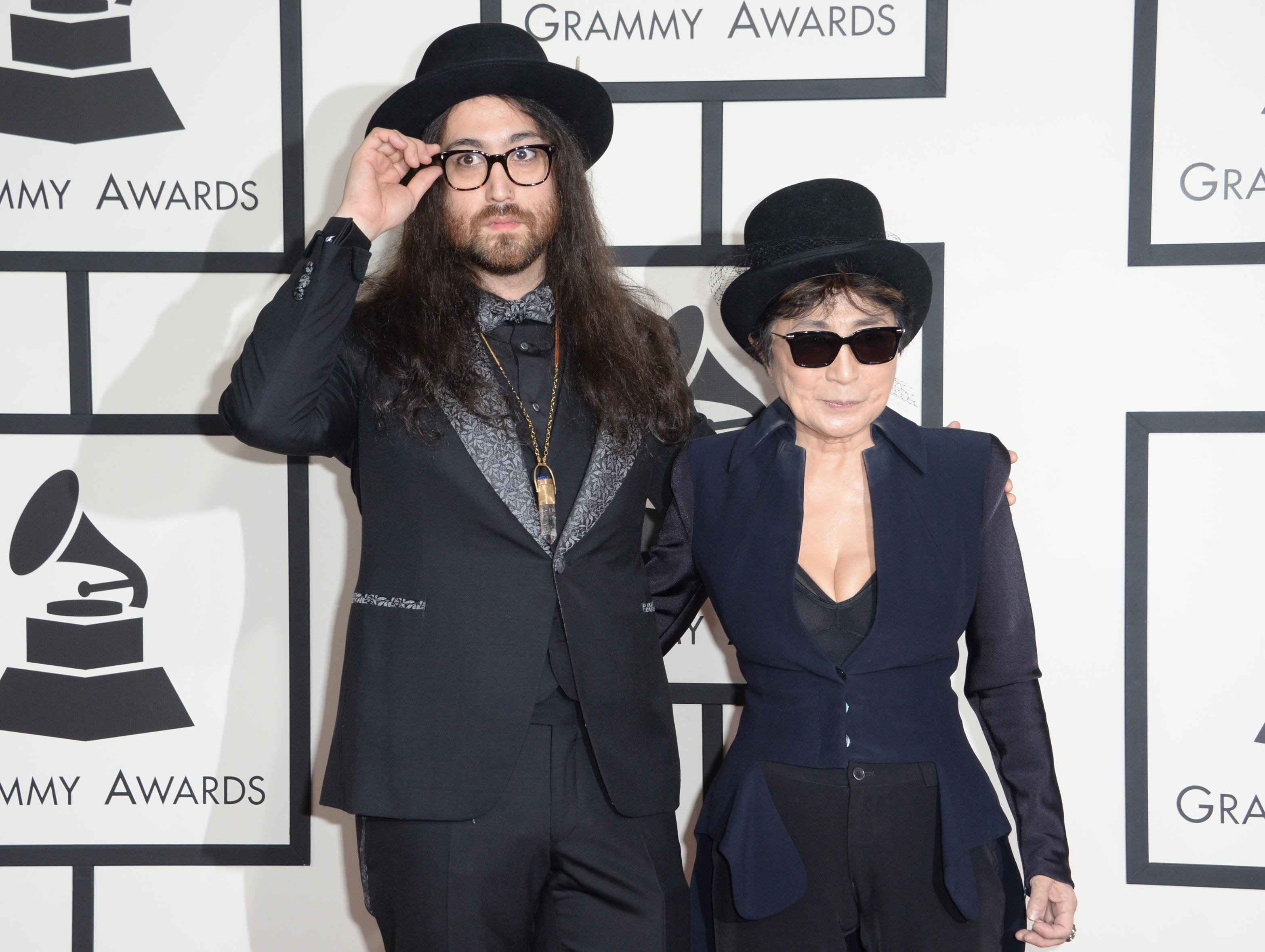 Yoko Ono poses with son Sean Lennon on the red carpet  during the 56th Grammy Awards at the Staples Center in Los Angeles, California, January 26, 2014.