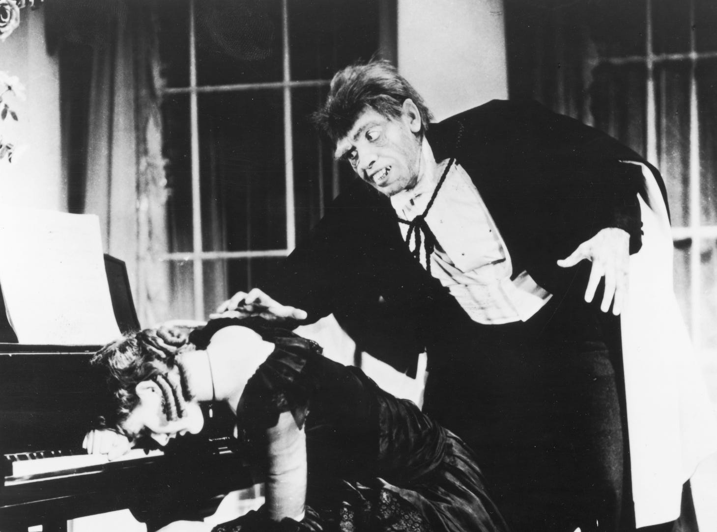 """Fredric March, right, in a scene from the 1932 motion picture """"Dr. Jekyll and Mr. Hyde."""" March won the Academy Award for Best Actor for his performance that year."""