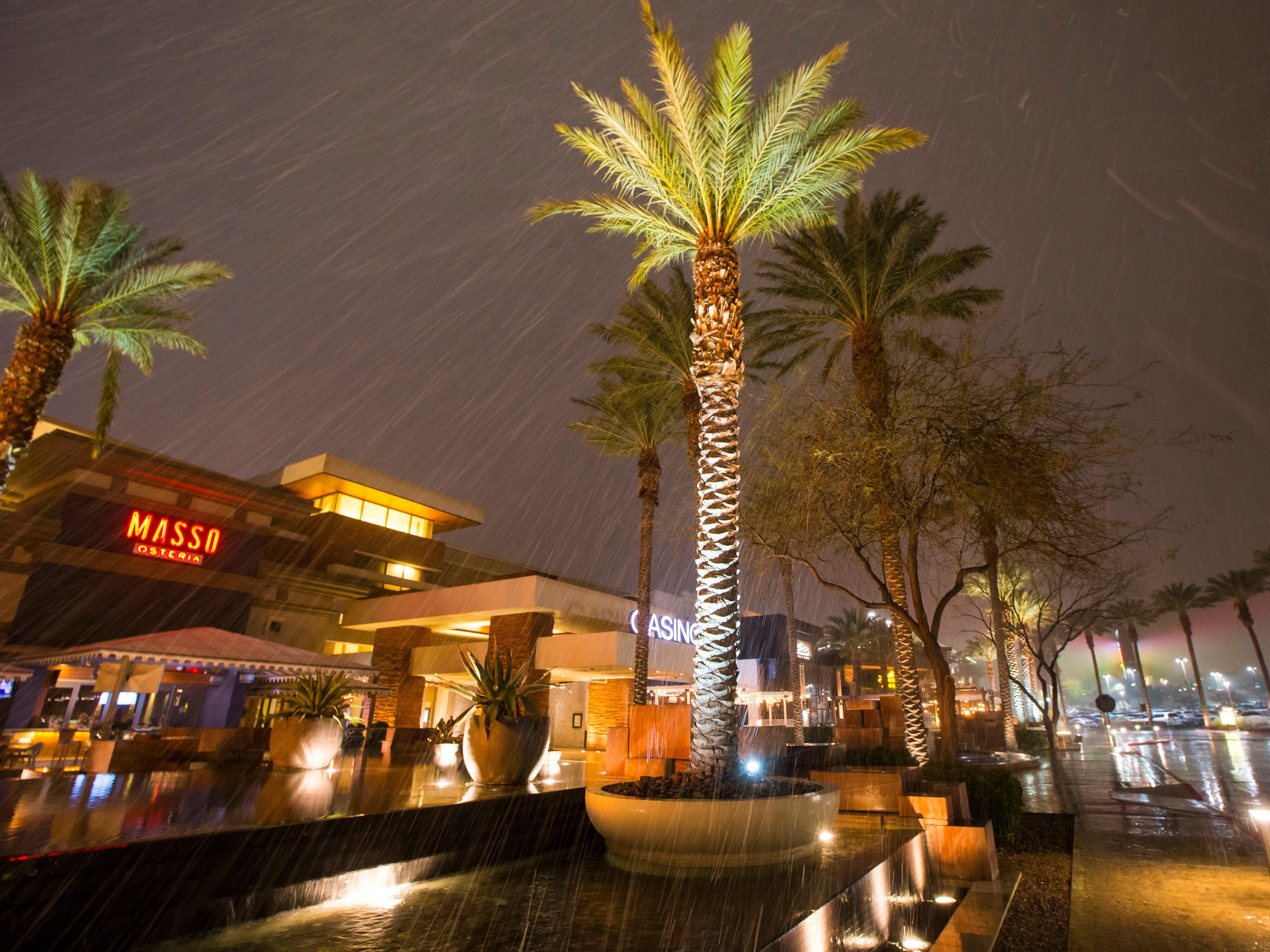 Snow falls outside the Red Rock Resort in Las Vegas on Feb. 20, 2019.