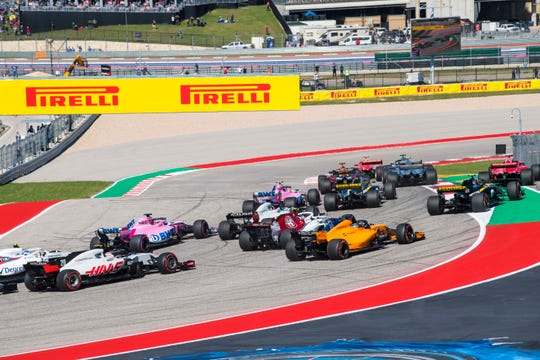 The Formula One field drives through turn one at the start of the United States Grand Prix at Circuit of the Americas.