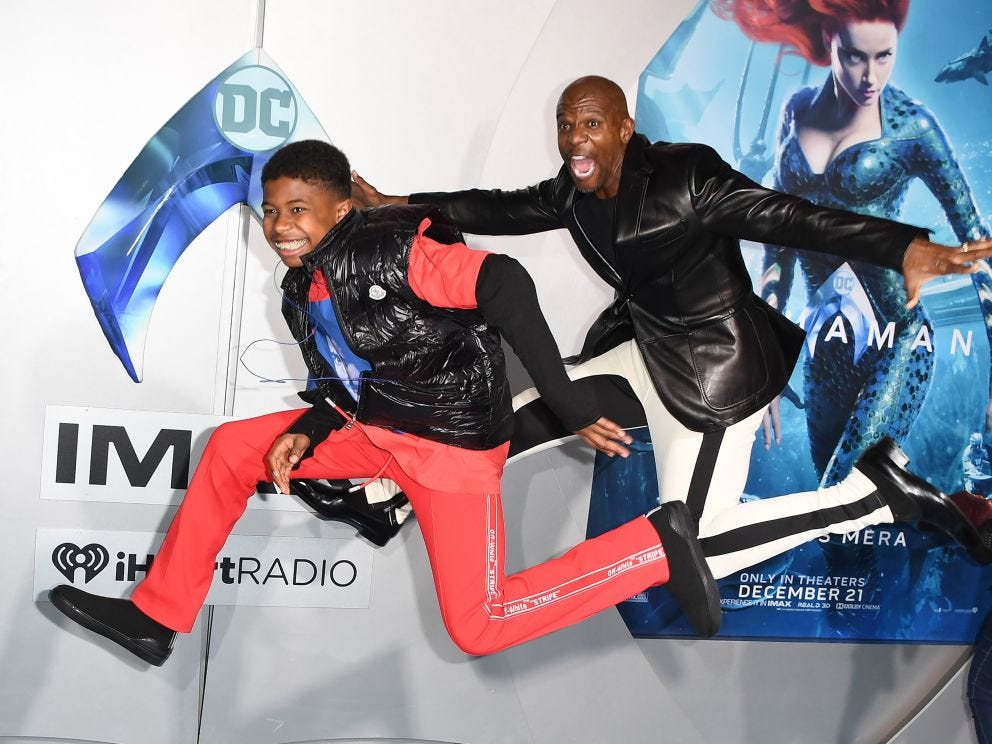 "US actor Terry Crews and his son Isaiah Crews arrive for the world premiere of ""Aquaman"" at the TCL Chinese theatre in Hollywood on December 12, 2018."