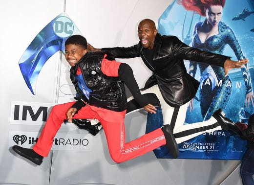 "Terry Crews and son Isaiah Crews arrive for the world premiere of ""Aquaman"" at the TCL Chinese theatre in Hollywood on Dec. 12, 2018. MARK RALSTON, AFP/Getty Images"