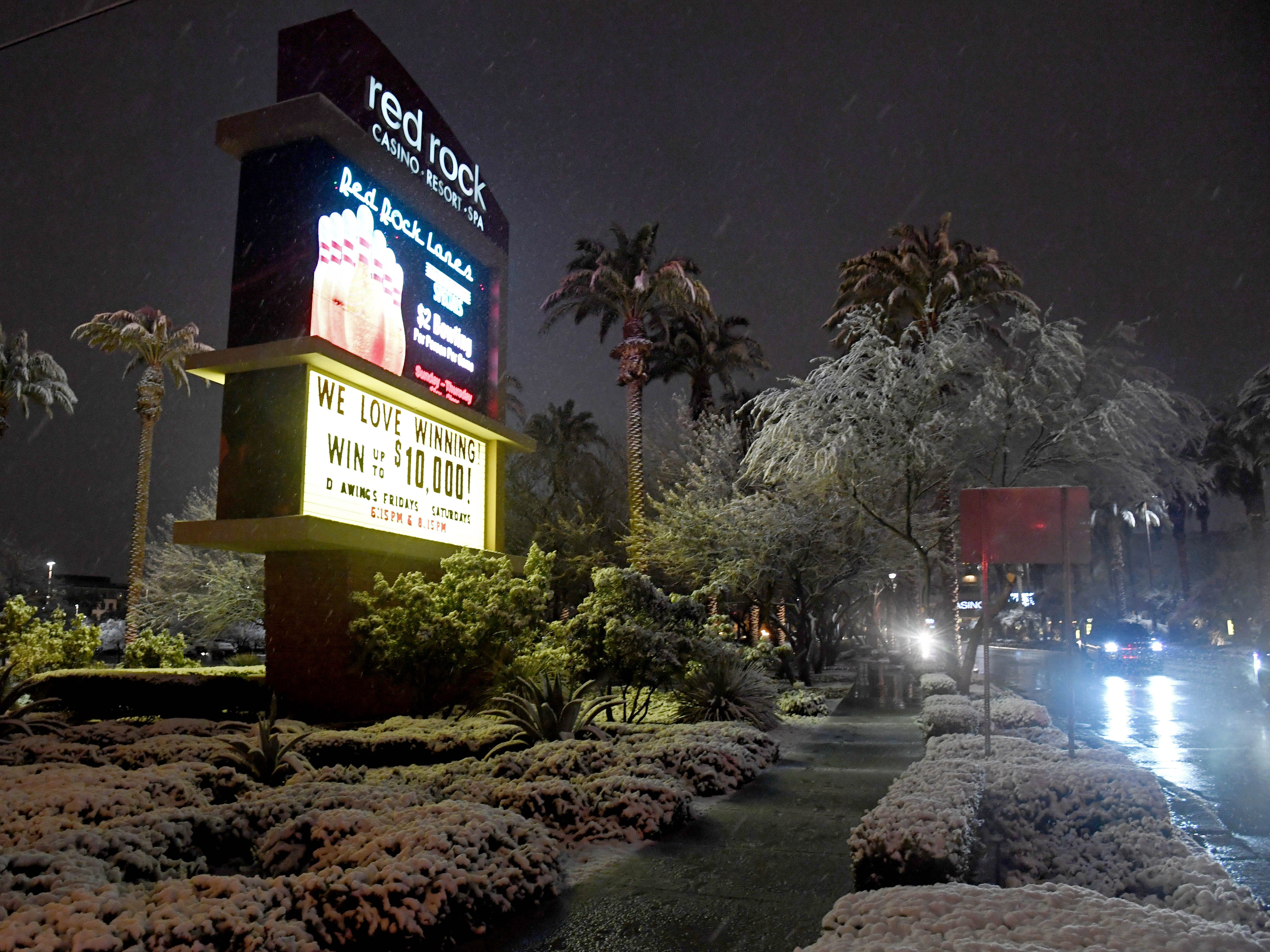 Snow falls outside the Red Rock Casino in Las Vegas during a winter storm on Feb. 20, 2019.