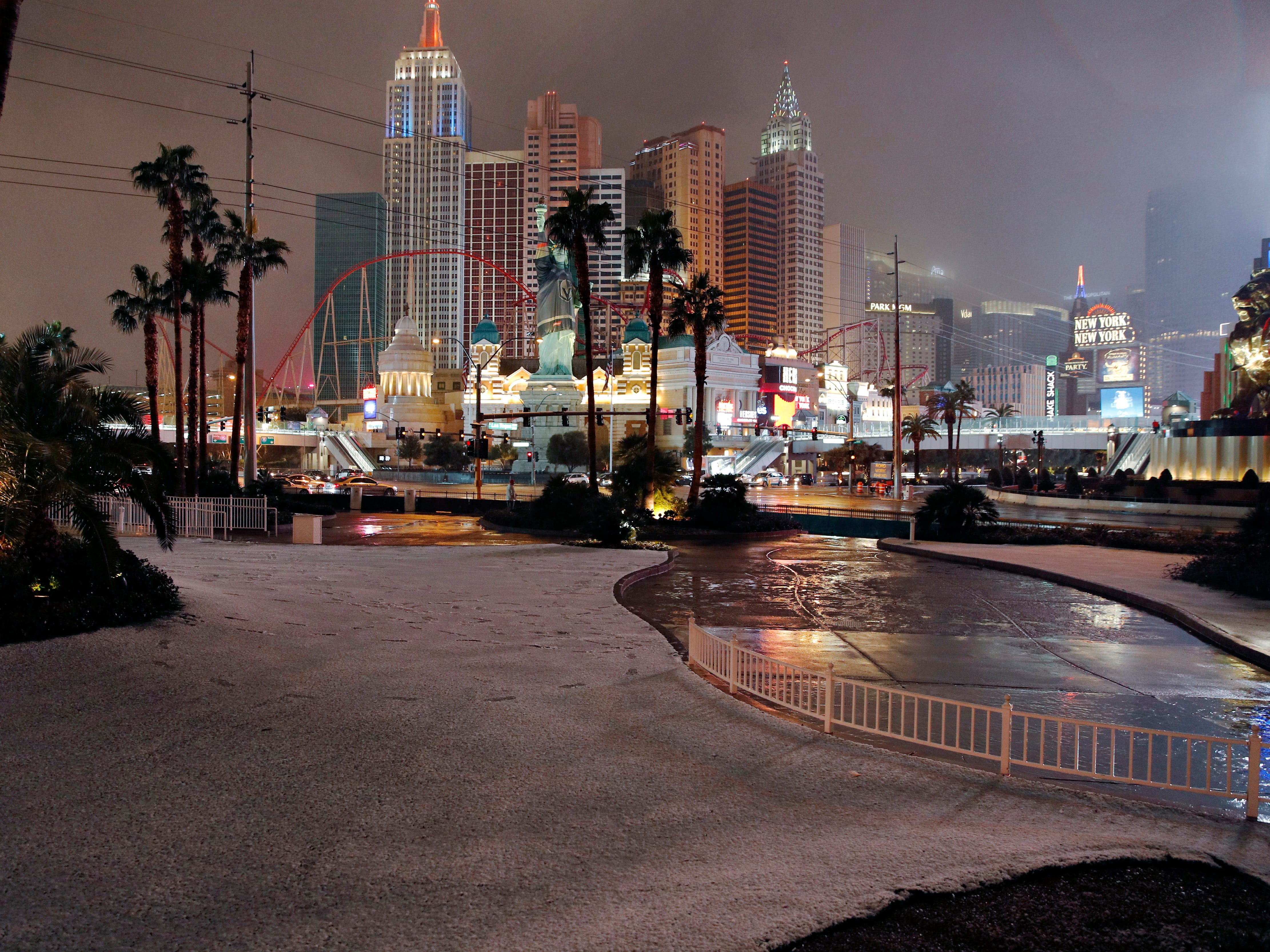 A dusting of snow covers an area along the Las Vegas Strip on Feb. 21, 2019.