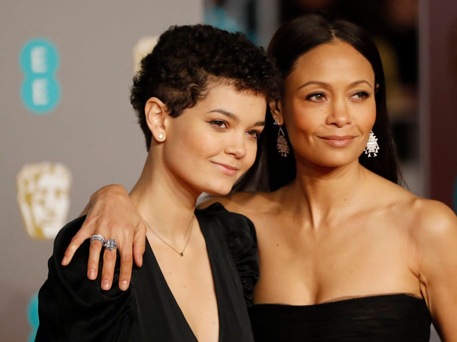 British actress Thandie Newton and daughter Ripley Parker pose on the red carpet upon arrival at the BAFTA British Academy Film Awards at the Royal Albert Hall in London on February 10, 2019.