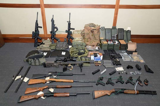 Weapons seized at the Silver Spring, Maryland, home of US Coast Guard officer Christopher Paul Hasson. He espoused white supremacist views and drafted a target list of Democratic politicians and prominent media figures and was arrested on firearms and drug charges on Feb. 15, 2019.