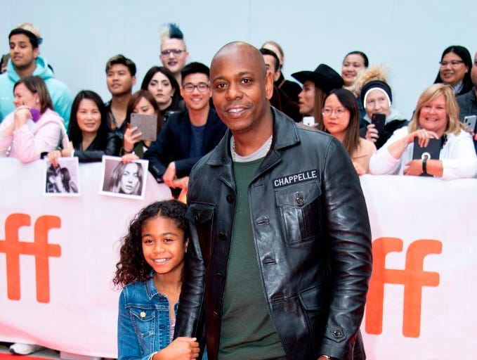 "Stand up comedian Dave Chappelle and his daughter Sonal Chappelle attend the premiere of ""A Star is Born"" during the Toronto International Film Festival on September 9, 2018, in Toronto, Ontario, Canada."