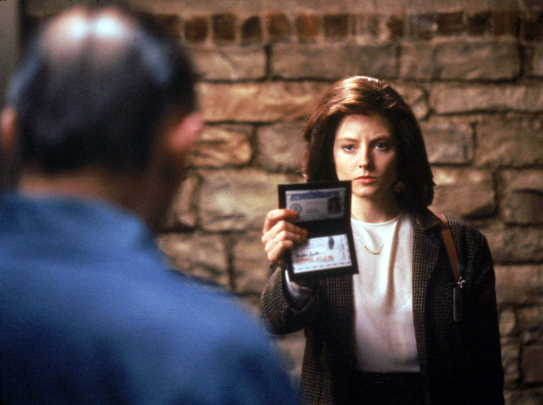 Anthony Hopkins, back to camera, and Jodie Foster in a scene from the 1991 motion picture The Silence of the Lambs.