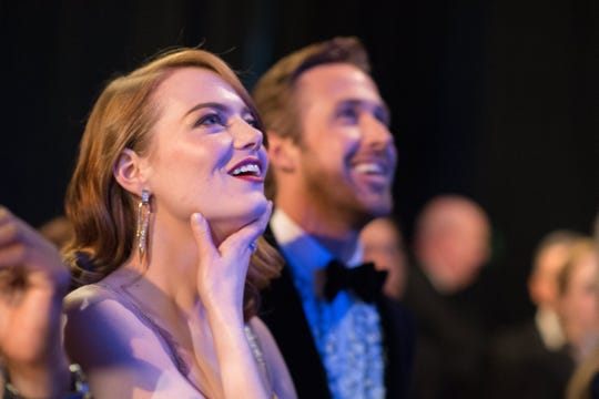 Emma Stone and Ryan Gosling watch the show backstage at the 89th annual Academy Awards ceremony.