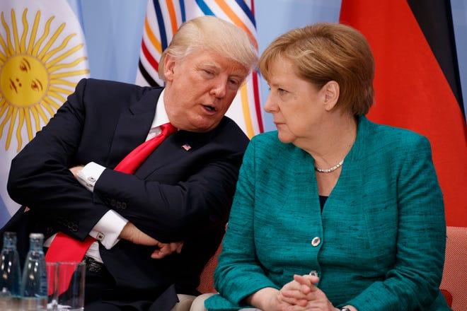 President Trump, left, talks with German Chancellor Angela Merkel during the Women's Entrepreneurship Finance event at the G20 Summit on July 8, 2017, in Hamburg, Germany.