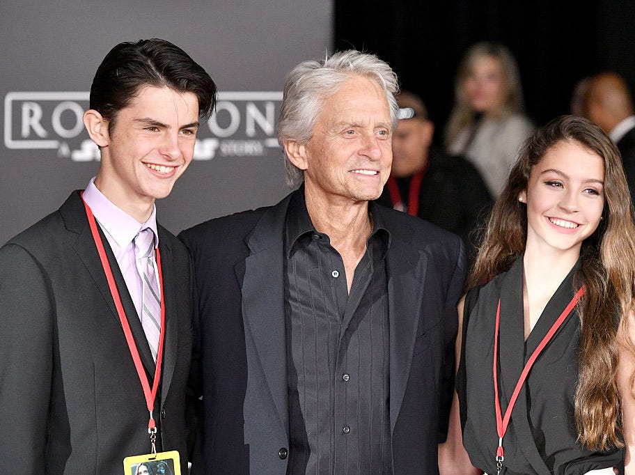 "(L-R) Dylan Michael Douglas, Michael Douglas and Carys Zeta-Douglas attend the premiere of Walt Disney Pictures and Lucasfilm's ""Rogue One: A Star Wars Story"" at the Pantages Theatre on December 10, 2016 in Hollywood, California."