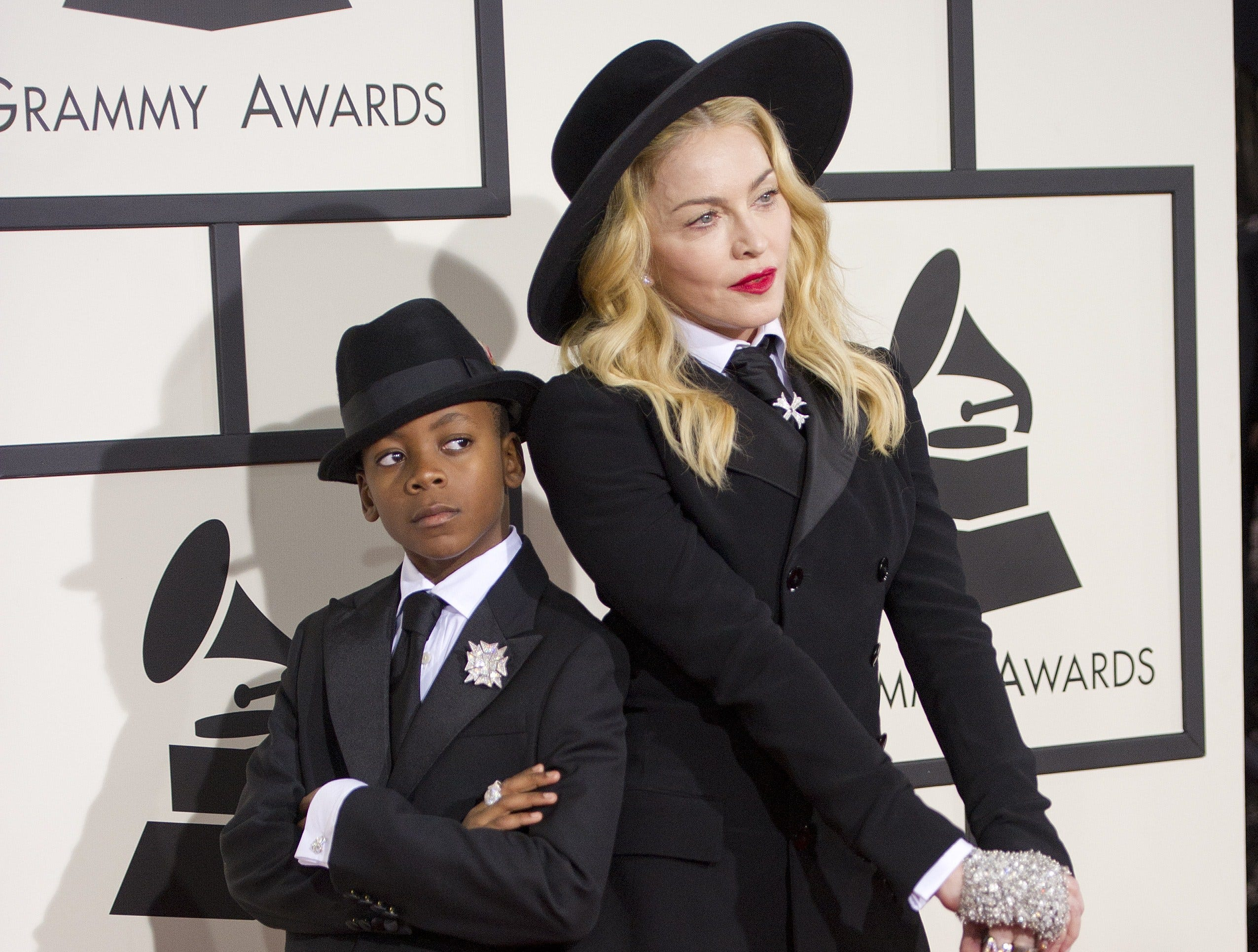 Madonna and son David Banda pose on the red carpet for the 56th Grammy Awards at the Staples Center in Los Angeles on January 26, 2014.