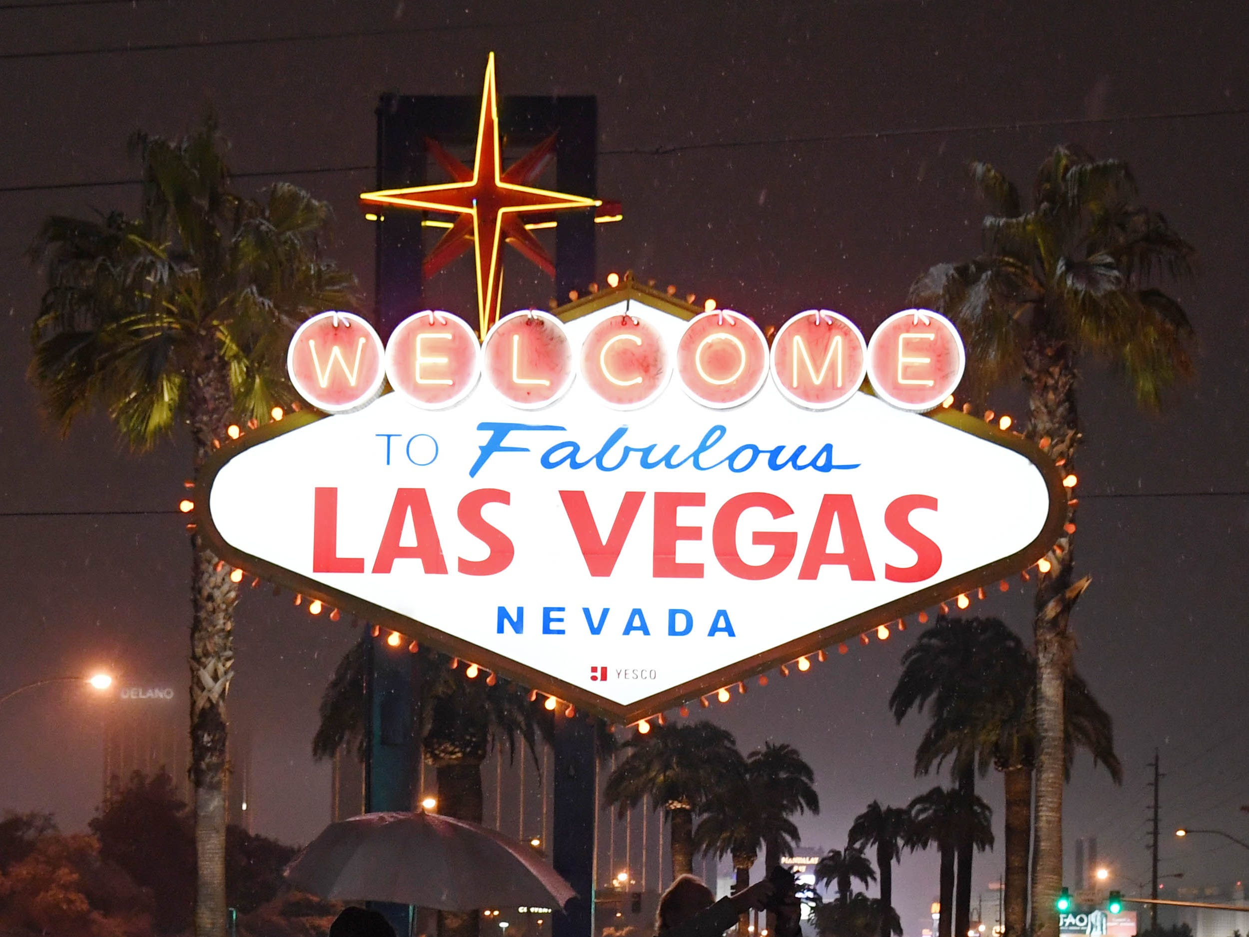 """Visitors take photos at the """"Welcome to Fabulous Las Vegas"""" sign during a winter storm on Feb. 20, 2019."""