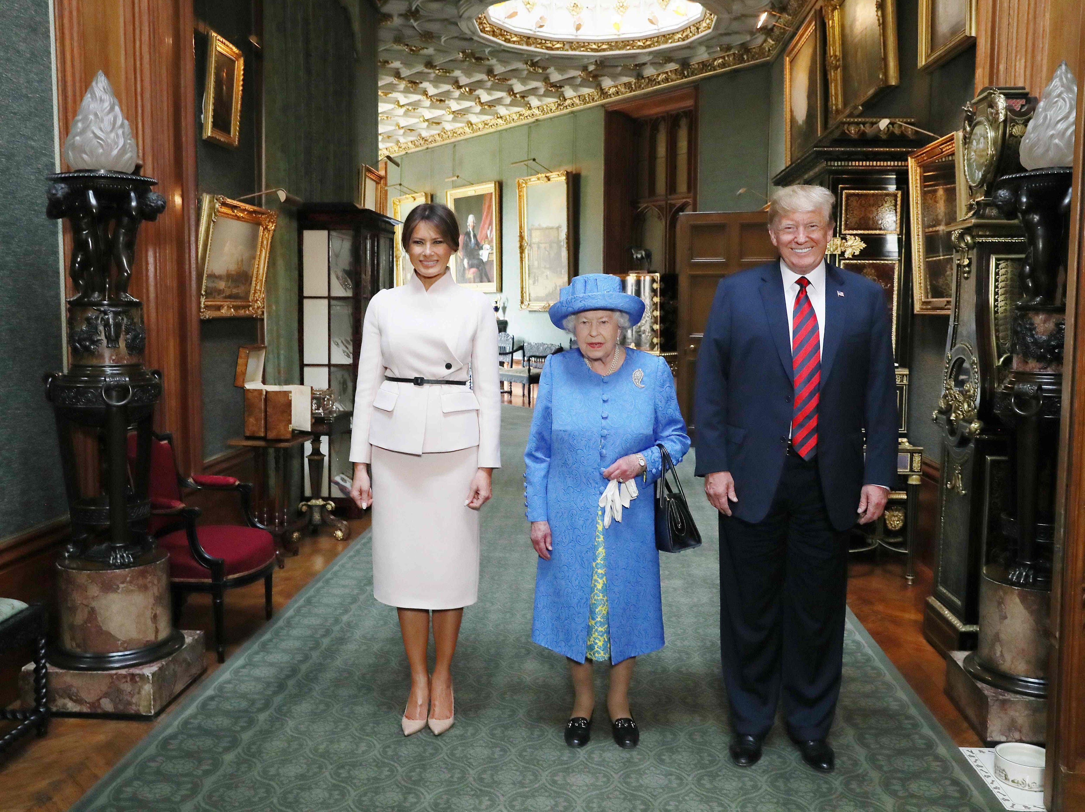 Britain's Queen Elizabeth II stands with President Trump and First Lady Melania Trump in the Grand Corridor at Windsor Castle in Windsor, west of London, on July 13, 2018.