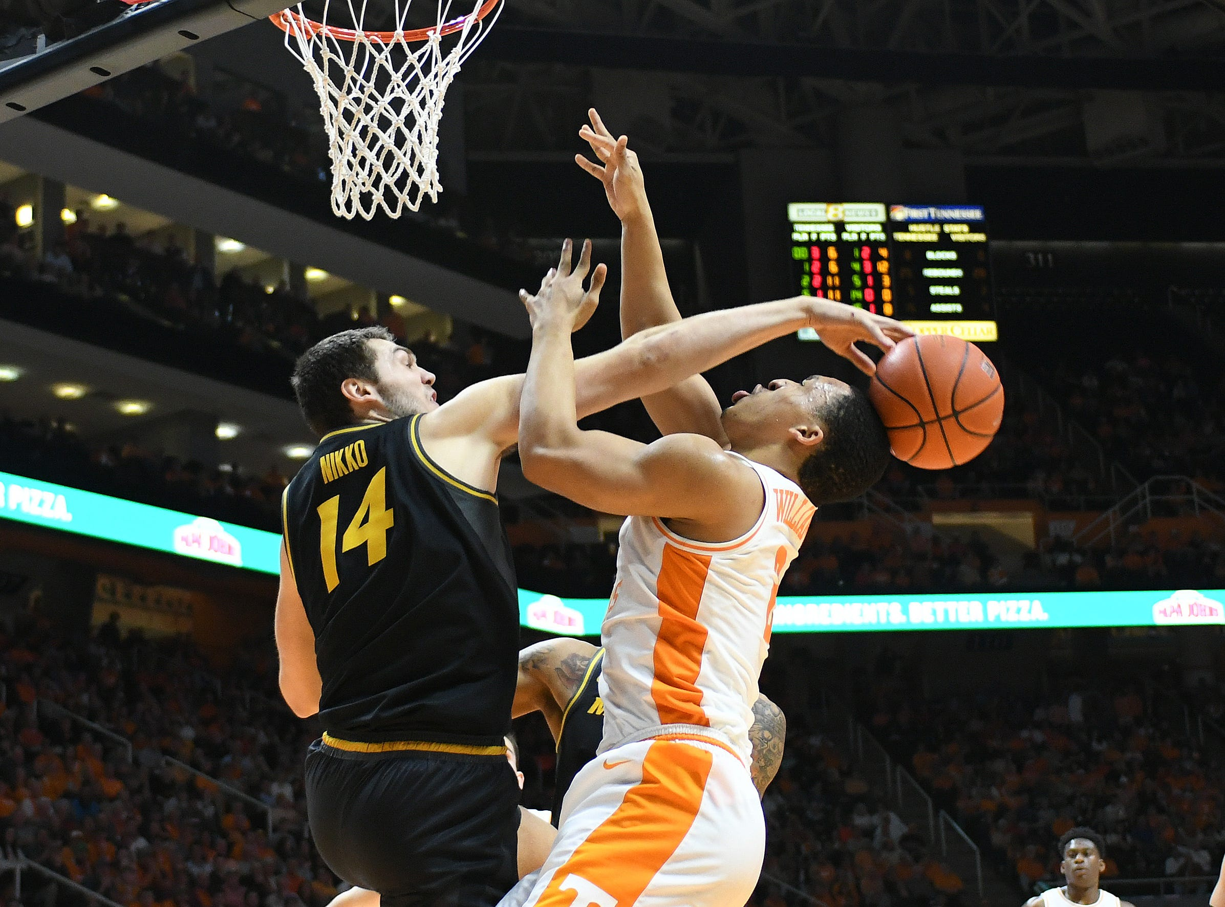 Feb. 5: Missouri Tigers forward Reed Nikko (14) blocks a shot by Tennessee Volunteers forward Grant Williams (2) during the second half at Thompson-Boling Arena.