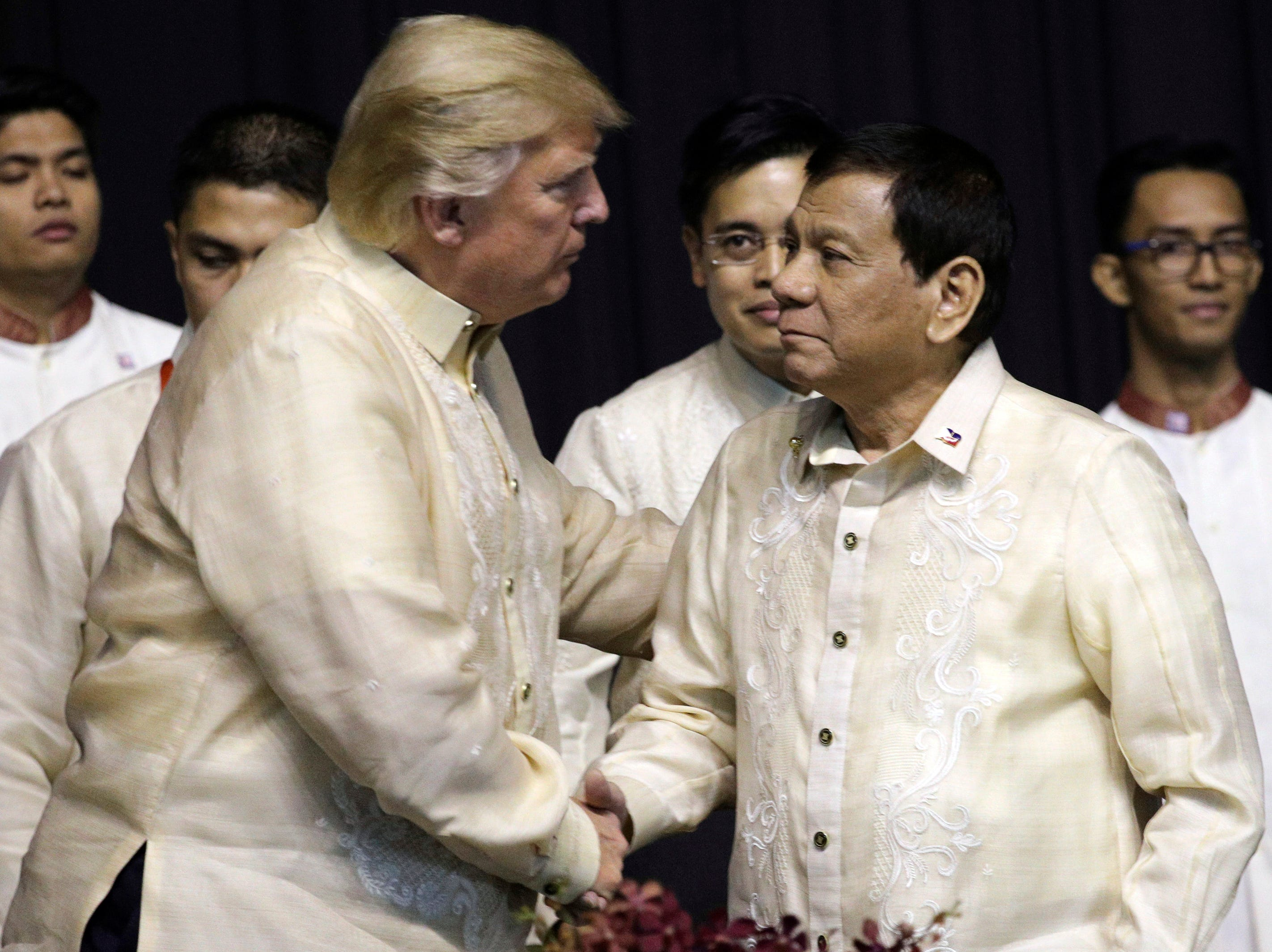 President Trump shakes hands with Philippines President Rodrigo Duterte  during the gala dinner marking ASEAN's 50th anniversary in Manila, Philippines, on Nov. 12, 2017.