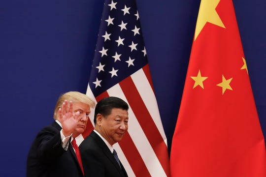 President Trump walks with Chinese President Xi Jinping after attending a business event at the Great Hall of the People in Beijing on Nov. 9, 2017.