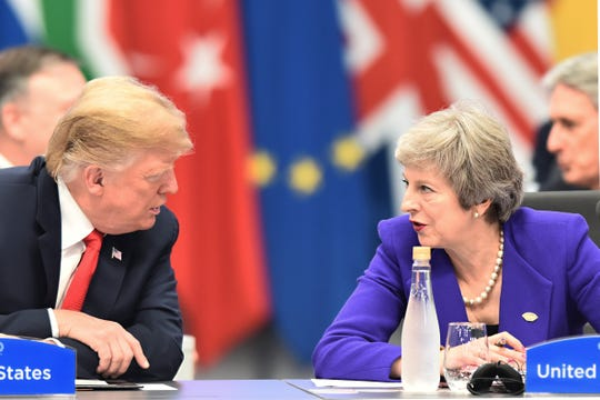 President Donald Trump talks with British Prime Minister Theresa May during the opening day of Argentina G20 Leaders' Summit 2018 at Costa Salguero on Nov. 30, 2018, in Buenos Aires.