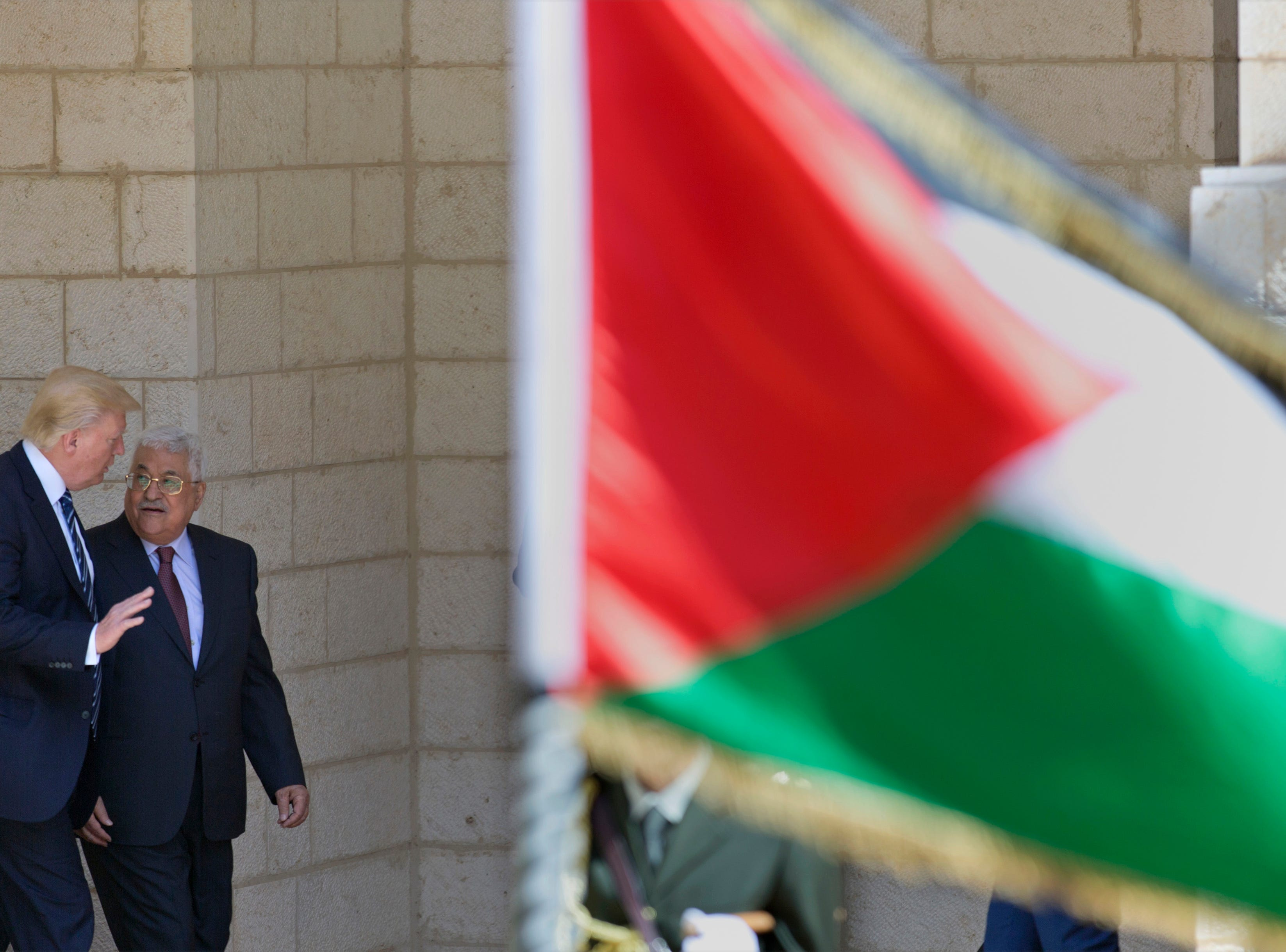 President Trump walks with Palestinian President Mahmoud Abbas after his arrival in the West Bank city of Bethlehem, on May 23, 2017.