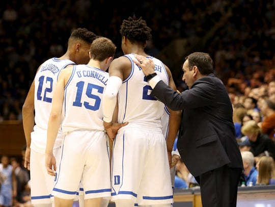Duke coach Mike Krzyzewski talks to his Zion Williamson-less team against the North Carolina Tar Heels.