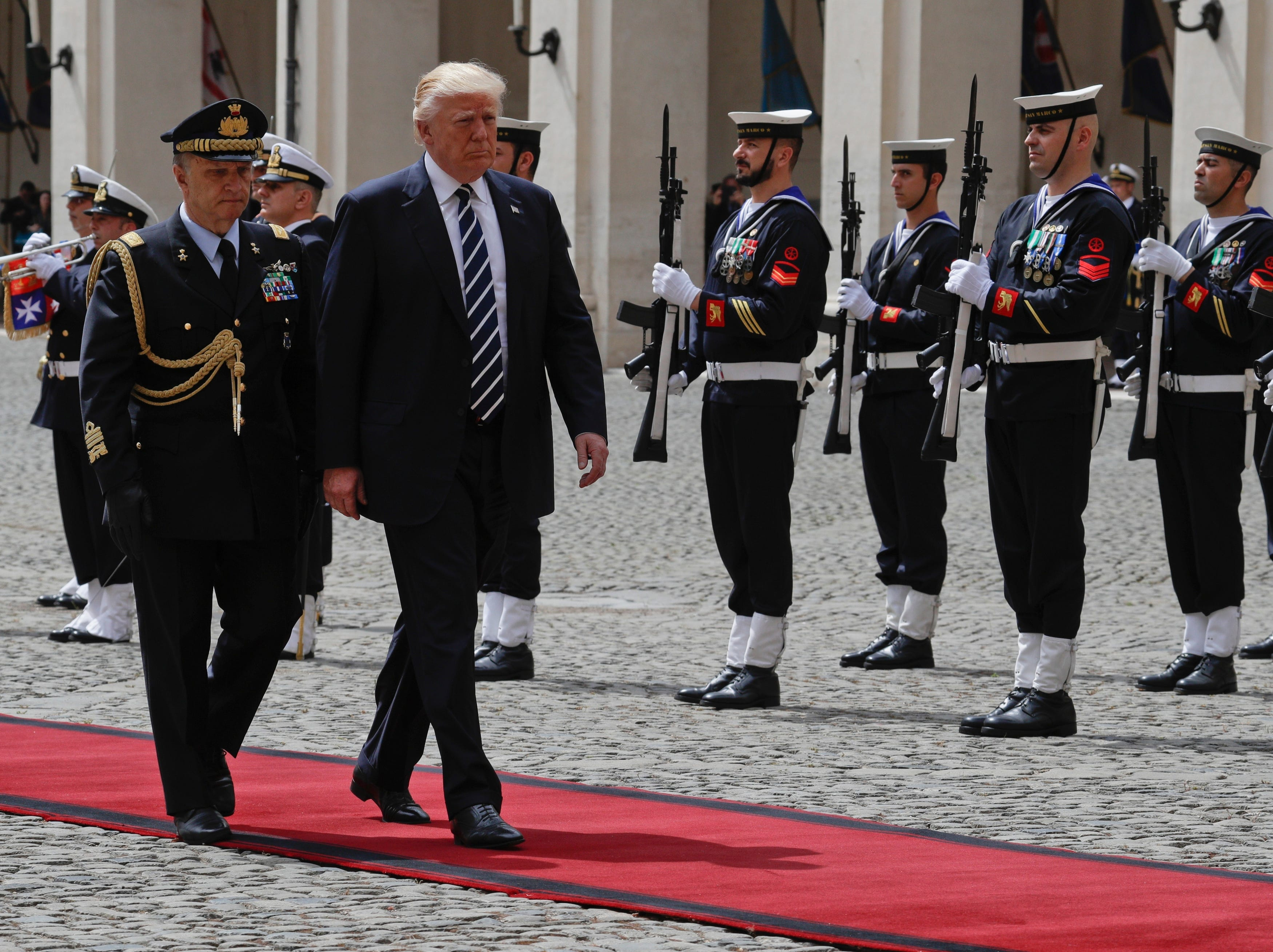 President Trump and Italian Military Advisor Gen. Roberto Corsini review the honor guard at the Quirinale Presidential palace prior to his meeting with Italian President Sergio Mattarella, in Rome on May 24, 2017.