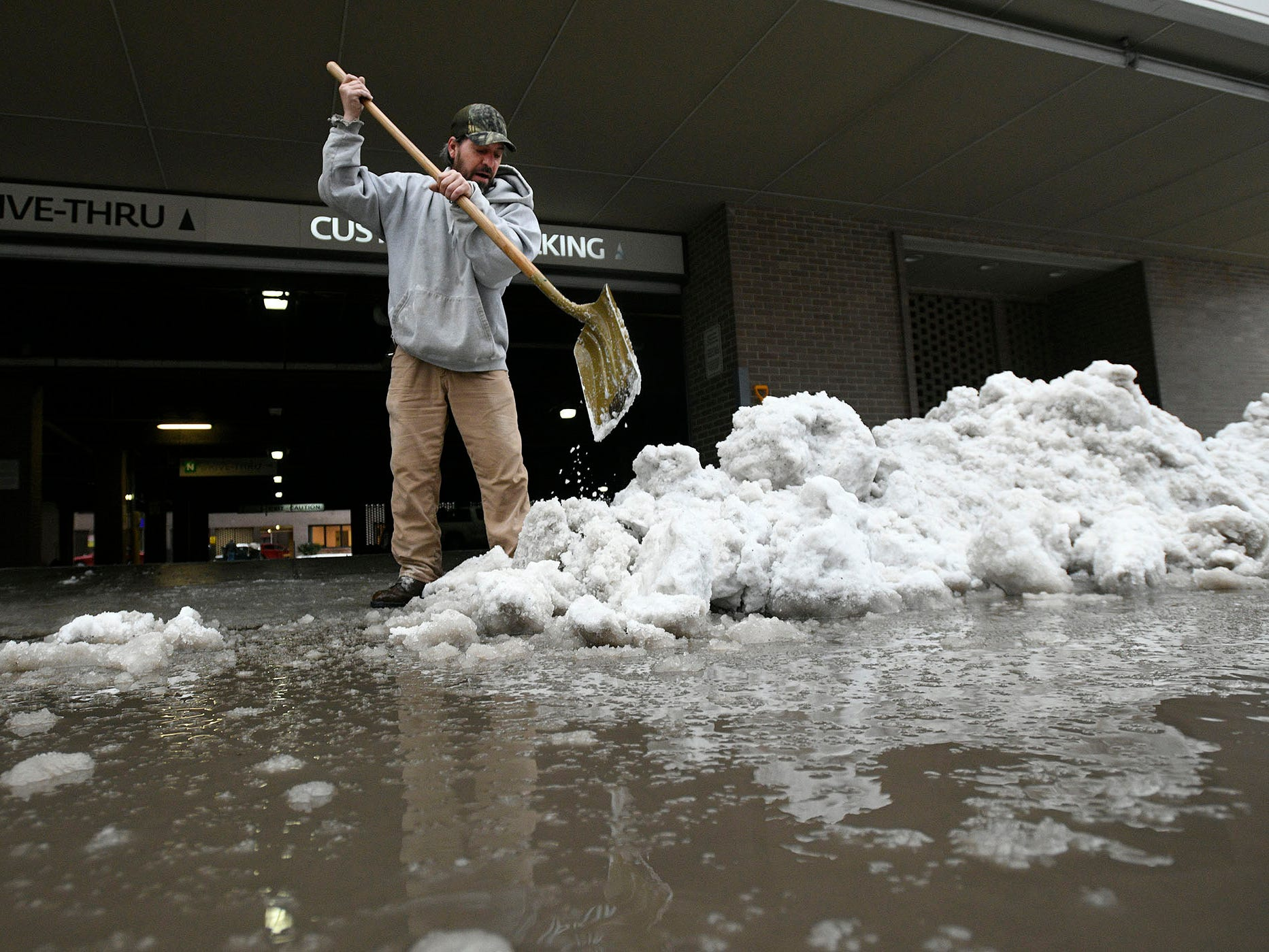 Chuck Ream clears the entrance way to a parking garage in Johnstown, Pa. Fed. 21, 2019.