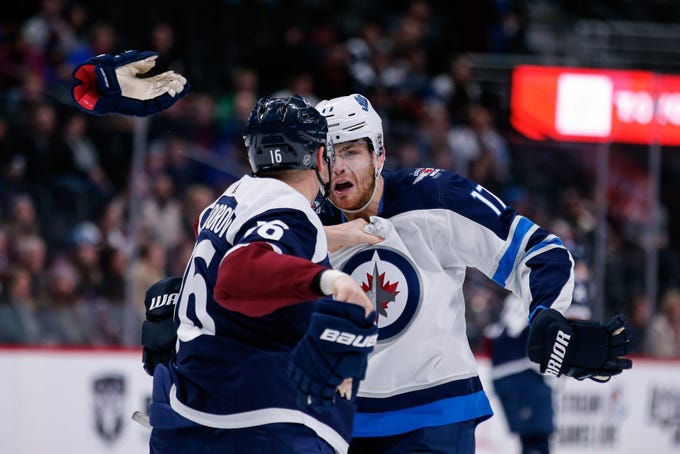 Feb. 20: Colorado Avalanche's Nikita Zadorov vs. Winnipeg Jets' Adam Lowry.
