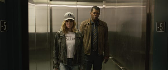 """Carol Danvers (Brie Larson) and Nick Fury (Samuel L. Jackson) team up with a cat in the new superhero movie """"Captain Marvel."""""""