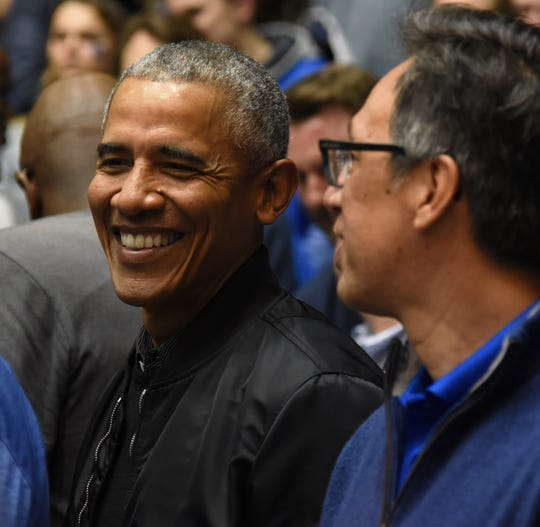 Former President Barack Obama looks on during the first half between the Duke Blue Devils and North Carolina Tar Heels.