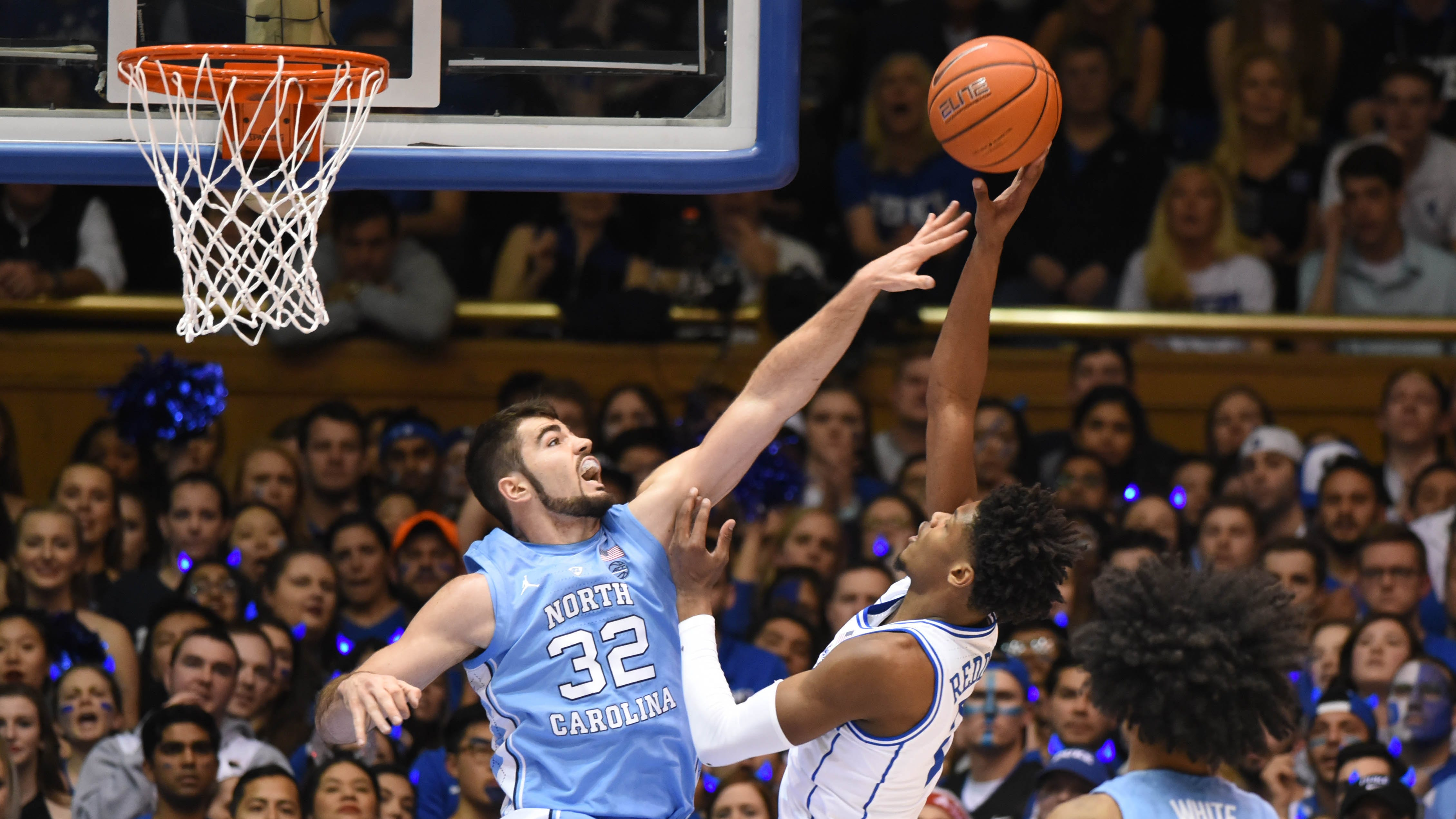 Feb 20, 2019; Durham, NC, USA; Duke Blue Devils forward Cam Reddish (2) shoots over North Carolina Tar Heels forward Luke Maye (32) during the first half at Cameron Indoor Stadium. Mandatory Credit: Rob Kinnan-USA TODAY Sports