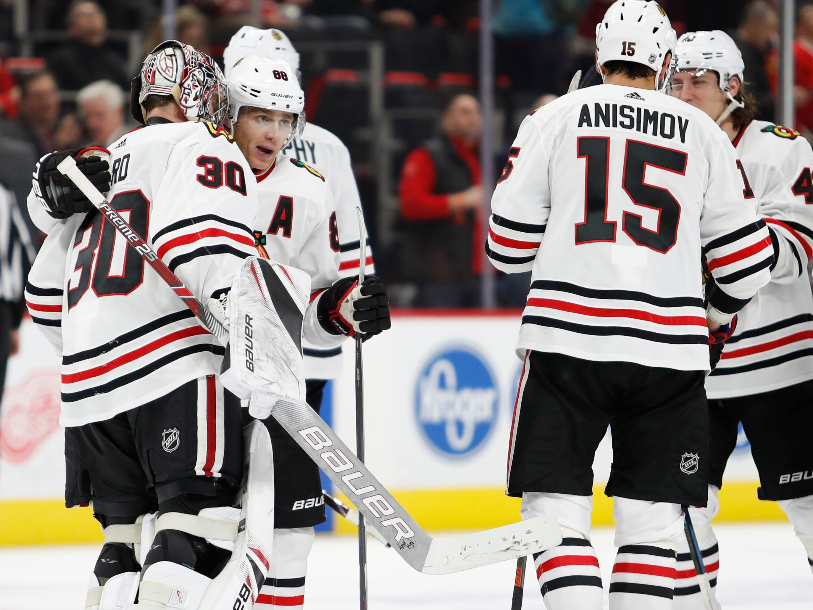 Feb. 20: Chicago Blackhawks winger Patrick Kane (second from left) celebrates his overtime goal in a 5-4 win against the Detroit Red Wings. He scored twice to extend his point streak to 19 games, but his assist streak ended at 17 games.