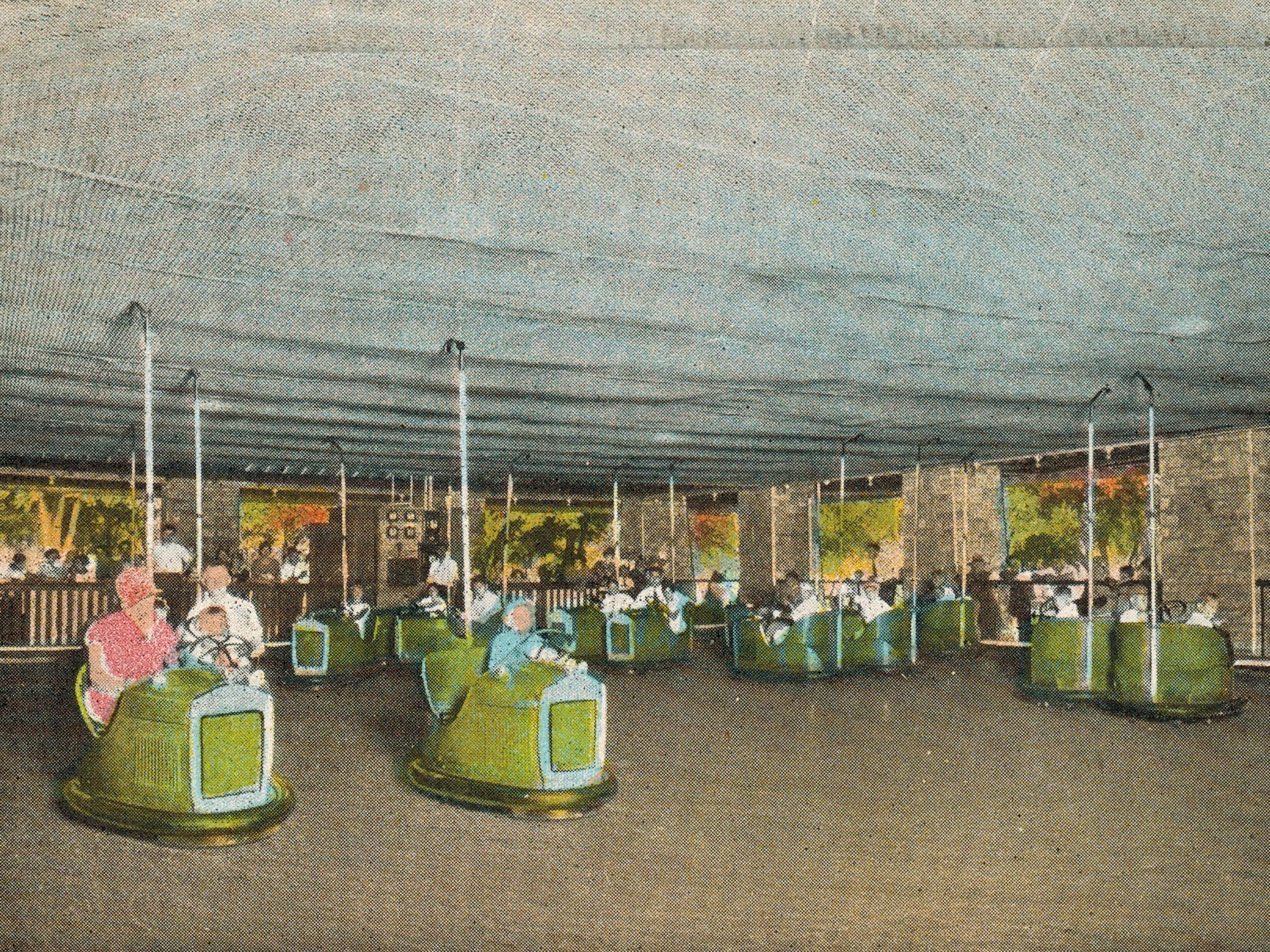 They included long contact poles that scraped along an electrified grid ceiling and transferred power to the cars. The distinctive poles remain to this day on many bumper car attractions